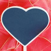 Heart shaped blackboard — Stock Photo