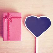 Gift box and heart — Stock Photo