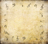 Music notes on old paper — Stock Photo