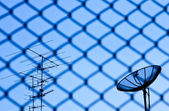 Wire fence with satellite — Stockfoto
