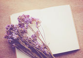Notebook and statice flowers — Foto Stock