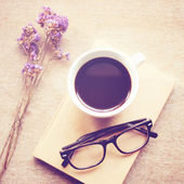 Black coffee on notebook — Стоковое фото