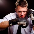 Boxing businessman throwing left hook. High contrast. — Stock Photo #19350307