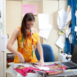 Authentic image of a tailor / fashion designer working — Stock Photo