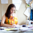 Authentic image of a fashion designer working in her studio — Stock Photo