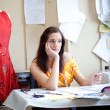 Royalty-Free Stock Photo: Fashion designer daydreaming in her studio