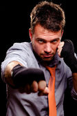 Boxing businessman throwing a jab. High contrast. — Stock Photo