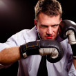 Boxing businessman throwing left hook. High contrast. - Stock Photo
