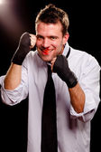 Businessman with wrapped hands guarding his face. High contrast. — Stock Photo