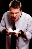Businessman spitting blood — Stock Photo