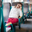 Young woman sleeping on the train — Stockfoto