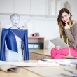 Stock Photo: Fashion designer in her studio