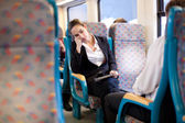 Tired businesswoman sleeping on the train — Stock Photo