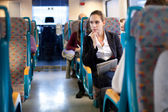 Pensive businesswoman on the train — Stock Photo