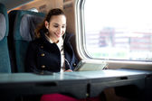 Young woman traveling on the train in business class — Stock Photo