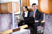 Business working on the train — Stock Photo