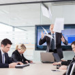 Mad CEO throwing documents at a meeting. Subordinates looking do — Stock Photo