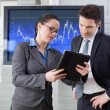 Businesswoman explaining future business plans to her colleague — Stock Photo #25083543