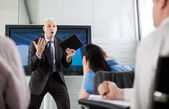 Boss yelling at his employees at a briefing — Stock Photo