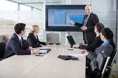行政解释业务计划对他的员工 — 图库照片