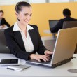 Friendly customer survice employee working in the office — Stock Photo #25323483