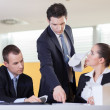 Annoying supervisor giving his coworkers a hard time during lunc — Stock Photo