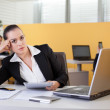 Bored businesswoman daydreaming in the office — Stock Photo