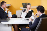 Business laughing during lunch break in the office — Stock Photo