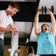 Stock Photo: Gym buddies working out in gym timing exercise