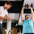 Gym buddies working out in gym timing exercise — Stock Photo