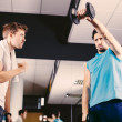 Young men working out in gym or health club — Stock Photo