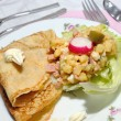 Pancake with cheese and vegetable salad, appetizer - Stock Photo