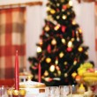 Christmas tree and laid table - Stock Photo