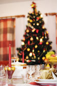 Christmas tree and laid table — Stok fotoğraf