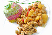 Pork asian style with colored rice — Stock Photo