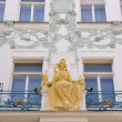 Statue on the facade of the building in prague — Stock Photo