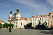 Prague St. Nicholas church and Jan Hus memorial — Stock Photo