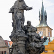 Prague Charles bridge Saint Ivo statue by M.B. Braun - Zdjęcie stockowe