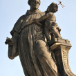 Statue Catholic saint Anthony of Padua with Baby Jesus on the Charles Bridge - Stock Photo