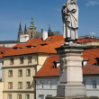 Saint Philip statue on Charles' Bridge in Prague - Stock Photo