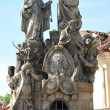 Statues of Saints John of Matha, Felix of Valois, and Ivan on the Charles Bridge in Prague - Stock Photo