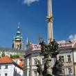 Prague - baroque column of Holy Trinity and st. Vitus cathedral - Stock Photo
