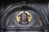 Sculpture mosaic of Jesus Christ on the monument in the cemetery — Stock Photo