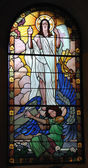 Risen Jesus on stained glass window — Stock Photo