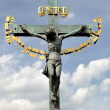 Crucifixion statue on Charles Bridge Prague — Stock Photo #19812471
