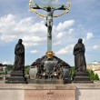 Crucifixion statue on Charles Bridge Prague — Stock Photo #19812599