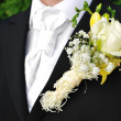 Rose on suit jacket of wedding groom — Stock Photo