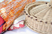 Colorful woven carpet and wicker basket — Stock Photo