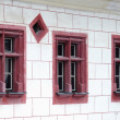 Stock Photo: Windows of historic building in mining town