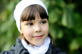 Portrait of little girl in white hat — Stock Photo